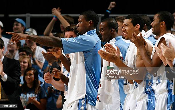 The North Carolina Tar Heels' bench cheers as the Blue Team scores against the UNC Asheville Bulldogs during the game at the Dean E Smith Center on...