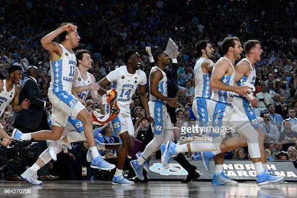 The North Carolina Tar Heels bench take to the court after winning the championship during the 2017 NCAA Men's Final Four National Championship game...