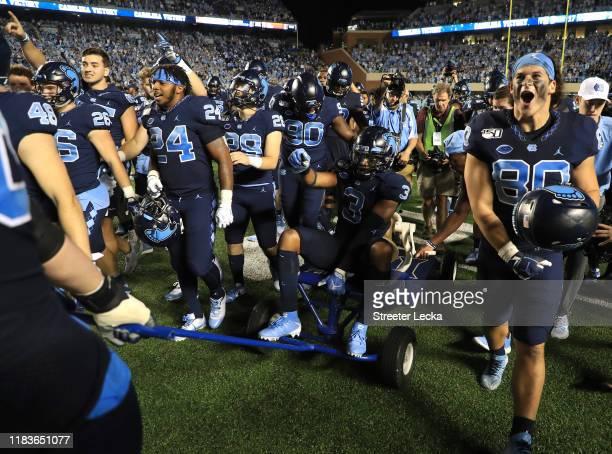 The North Carolina Tar Heels celebrate after defeating the Duke Blue Devils 2017 at Kenan Stadium on October 26 2019 in Chapel Hill North Carolina