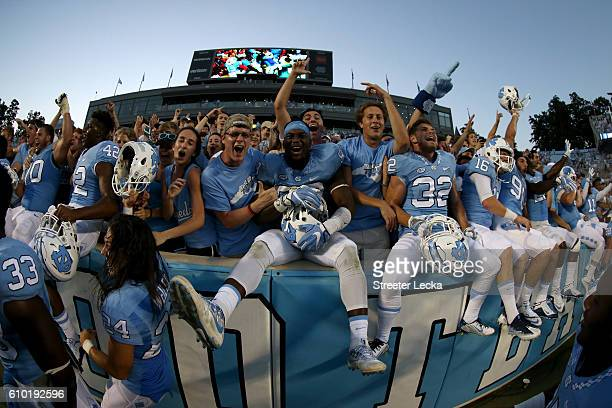 The North Carolina Tar Heels celebrate with fans after defeating the Pittsburgh Panthers 3736 at Kenan Stadium on September 24 2016 in Chapel Hill...