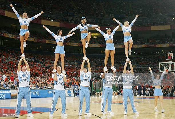 The North Carolina Tar Heels cheerleaders perform during the first half of the NCAA Men's Final Four against the Michigan State Spartans at the...
