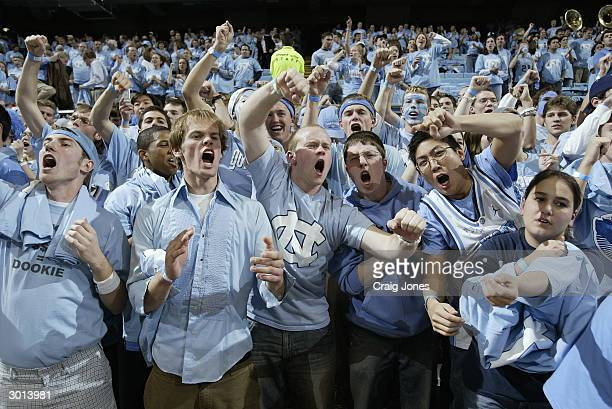 The North Carolina Tar Heels fans cheer during the game against the Duke Blue Devils on February 5, 2004 at the Dean Smith Center in Chapel Hill,...