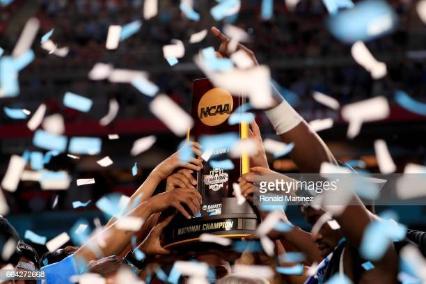 The North Carolina Tar Heels hold the championship trophy after defeating the Gonzaga Bulldogs during the 2017 NCAA Men's Final Four National...