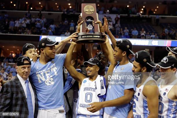 The North Carolina Tar Heels hold up the South Regional Champion trophy after defeating the Kentucky Wildcats during the 2017 NCAA Men's Basketball...