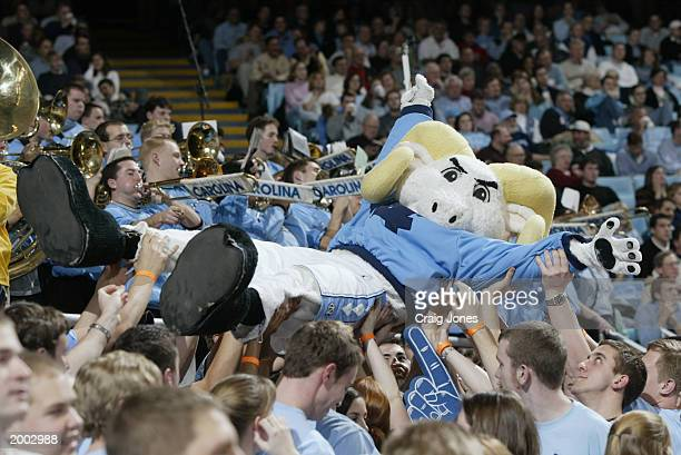 The North Carolina Tar Heel's mascot is held in the air by fans during the game against the Davidson Wildcats at Dean E. Smith Center on January 8,...