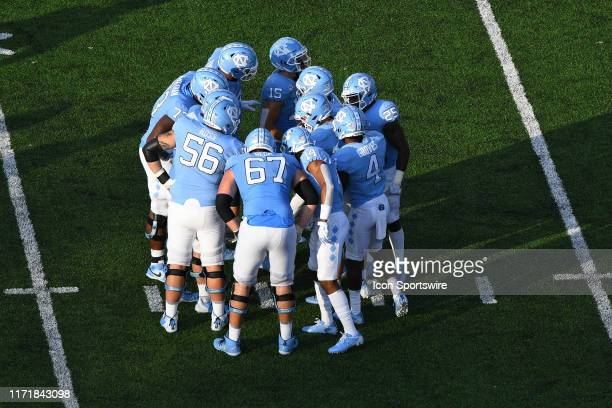 The North Carolina Tar Heels offense huddles up in the game between the Clemson Tigers and the North Carolina Tar Heels on September 28 2019 at Kenen...