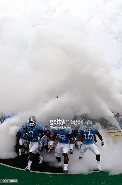 The North Carolina Tar Heels run onto the field against the East Carolina Pirates at Kenan Stadium on September 19 2009 in Chapel Hill North Carolina