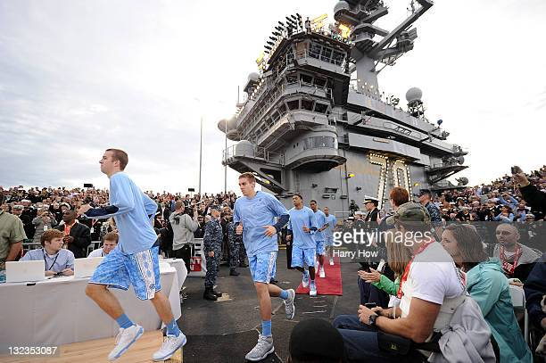 The North Carolina Tar Heels run out to the court before taking on the Michigan State Spartans during the NCAA men's college basketball Carrier...