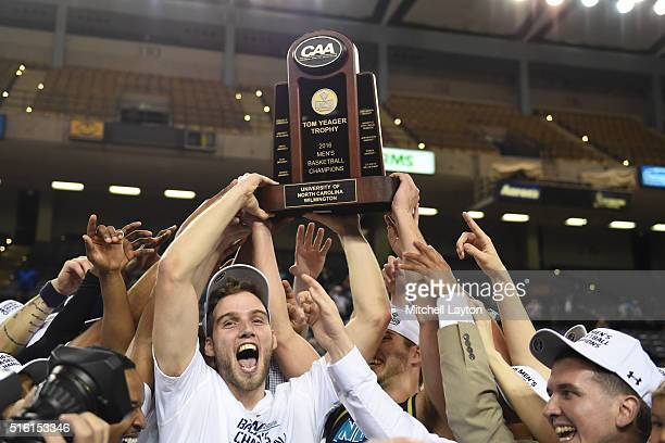 The North CarolinaWilmington Seahawks celebrate winning the Colonial Athletic Conference Tournament college basketball game against the Hofstra Pride...