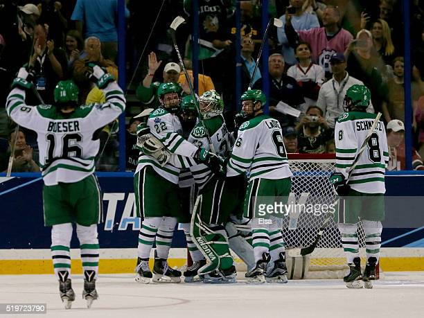 The North Dakota Fighting Hawks celebrate the win over the Denver Pioneers during semifinals of the 2016 NCAA Division I Men's Hockey Championships...