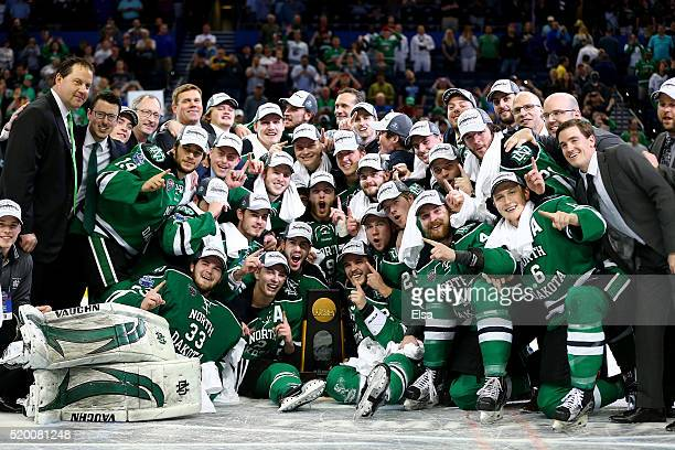 The North Dakota Fighting Hawks pose with the championship trophy of the 2016 NCAA Division I Men's Hockey Championships at Amalie Arena on April 9,...
