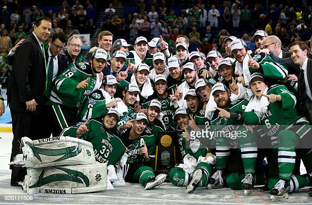 The North Dakota Fighting Hawks pose with the championship trophy of the 2016 NCAA Division I Men's Hockey Championships at Amalie Arena on April 9...