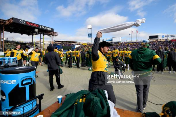 The North Dakota State Bison bench try to pump up the crowd against the James Madison Dukes during the Division I FCS Football Championship held at...