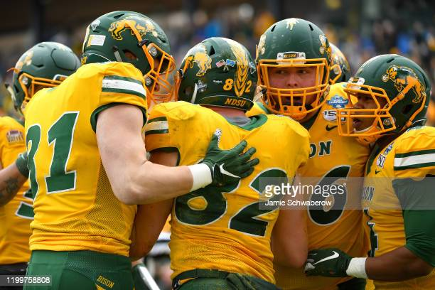 The North Dakota State Bison celebrate a play against the James Madison Dukes during the Division I FCS Football Championship held at Toyota Stadium...