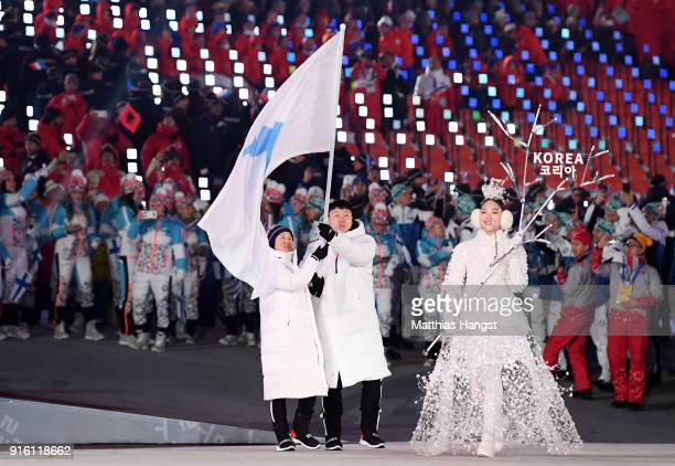 The North Korea and South Korea Olympic teams enter together under the Korean Unification Flag during the Parade of Athletes during the Opening...