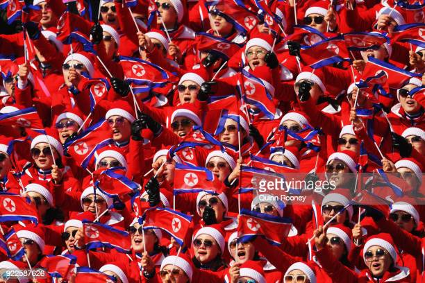 The North Korea cheerleader squad sing during the Men's Slalom on day 13 of the PyeongChang 2018 Winter Olympic Games at Yongpyong Alpine Centre on...