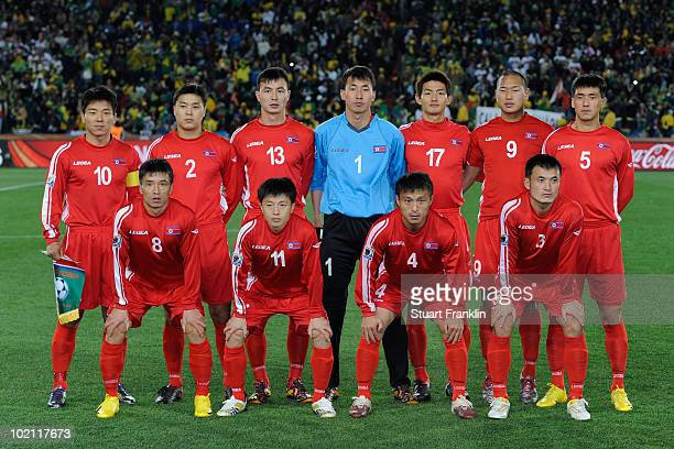 The North Korea team line up ahead of the 2010 FIFA World Cup South Africa Group G match between Brazil and North Korea at Ellis Park Stadium on June...