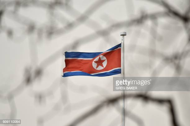 The North Korean flag flies above the North Korean embassy in Beijing on March 28 2018 North Korean leader Kim Jong Un was given a lavish welcome by...