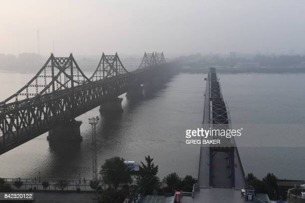 The North Korean town of Sinuiju is seen behind the Friendship Bridge which connects Sinuiju and the the Chinese border city of Dandong and the...