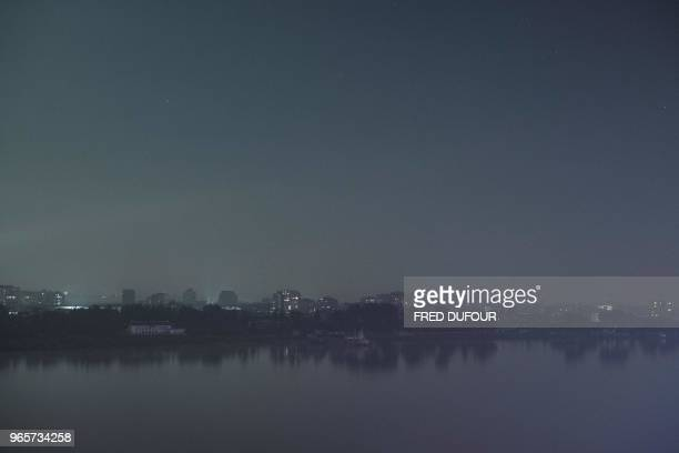 TOPSHOT The North Korean town of Sinuiju is seen from the Chinese border town of Dandong in China's northeast Liaoning province on May 31 2018 he...