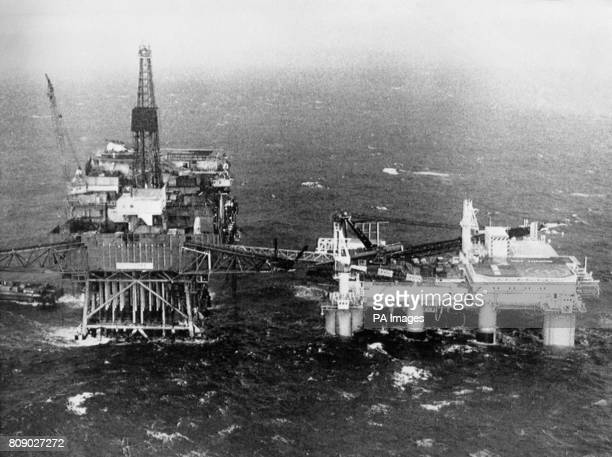 The North Sea oil production platform Piper Alpha left which was destroyed after an explosion which killed 167 men On the right is the support vessel...