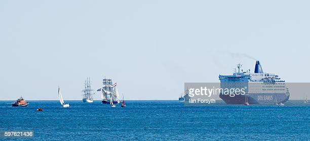 The North Sea Tall Ships Parade of Sail make their way past a DFDS Seaways ferry on August 29 2016 in Blyth England The bustling port town in South...