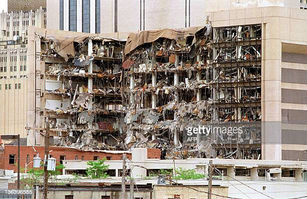 The north side of the Albert P Murrah Federal Building in Oklahoma City shows 19 April 1995 the devastation caused by a fueland fertilizer truck bomb...