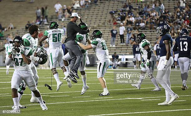 The North Texas Mean Green celebrate defeating the Rice Owls in double overtime at Rice Stadium on September 24 2016 in Houston Texas North Texas...