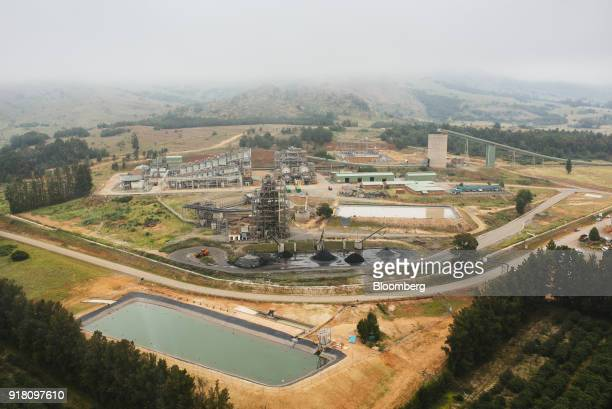 The Northam Platinum Ltd Booysendal platinum mine stands beyond a tailings dam for mining byproduct storage outside the town of Lydenburg in...