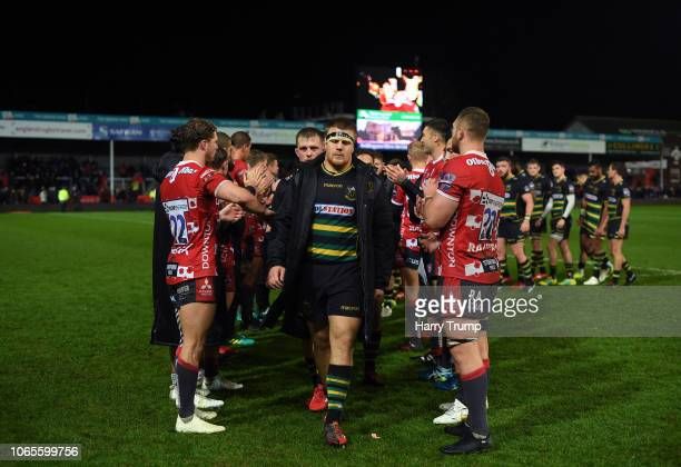 The Northampton Saints side cut dejected figures as they make their way through a tunnel of Gloucester Rugby players during the Premiership Rugby Cup...