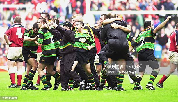 The Northampton team celebrate on the final whistle after beating Munster from Ireland 9-8 in the final of the Heineken Rugby Cup Final at...