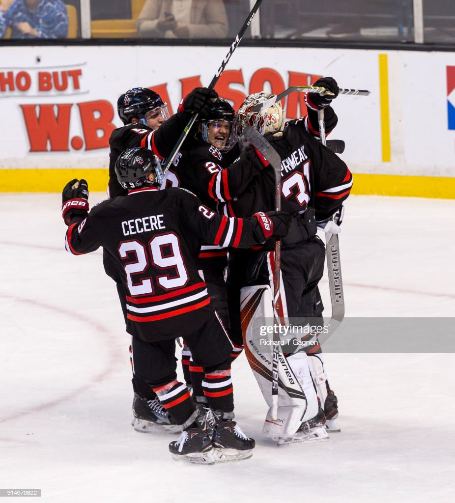 The Northeastern Huskies celebrate a 3-0 win against the Boston College Eagles after NCAA hockey in the semifinals of the annual Beanpot Hockey Tournament at TD Garden on February 5, 2018 in Boston, Massachusetts.