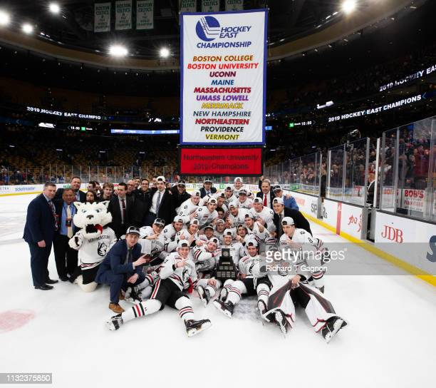 The Northeastern Huskies celebrate a 3-2 victory against the Boston College Eagles after NCAA hockey in the Hockey East Championship final at TD...