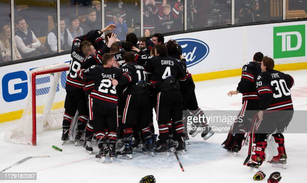 The Northeastern Huskies celebrate after a victory against the Boston College Eagles during NCAA hockey in the championship game of the annual...