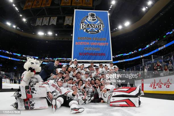 The Northeastern Huskies celebrate after defeating the Boston University Terriers in the 2020 Beanpot Tournament Championship game at TD Garden on...
