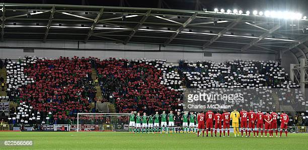 The Northern Ireland and Azerbaijan teams stand for a minutes silence on Armistice Day before the FIFA 2018 World Cup Qualifier between Northern...