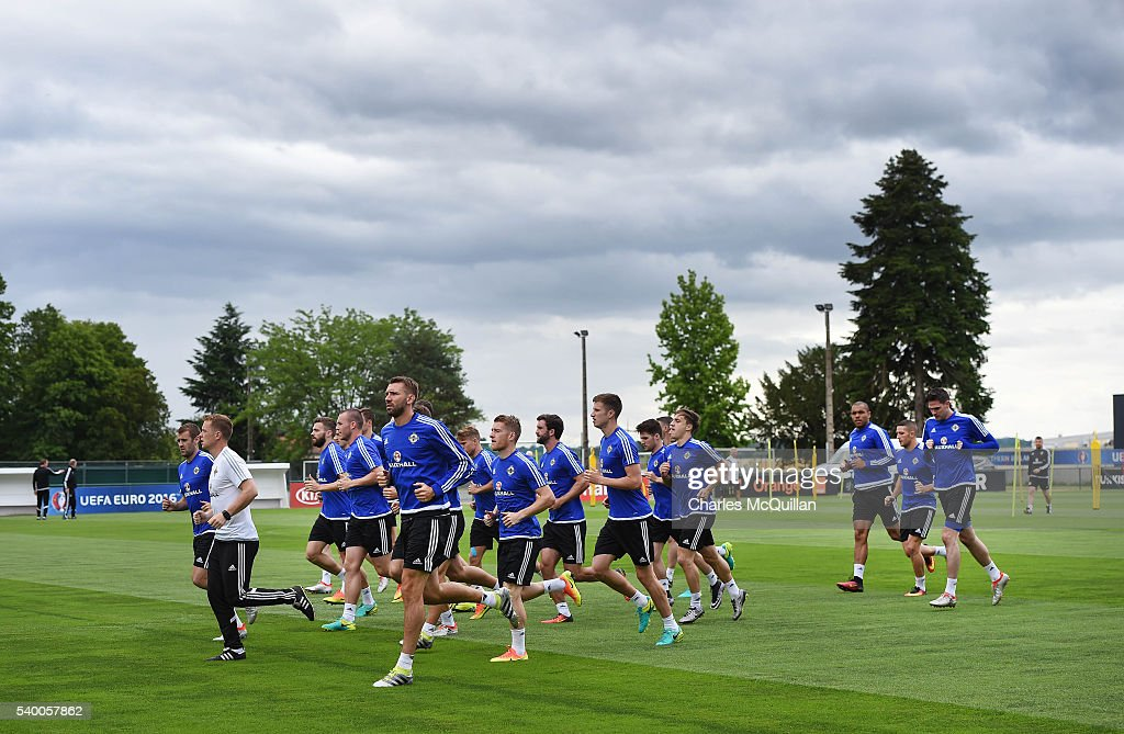 The Northern Ireland squad warm up at this mornings Northern Ireland team training session at their training camp on June 14, 2016 in Lyon, France.