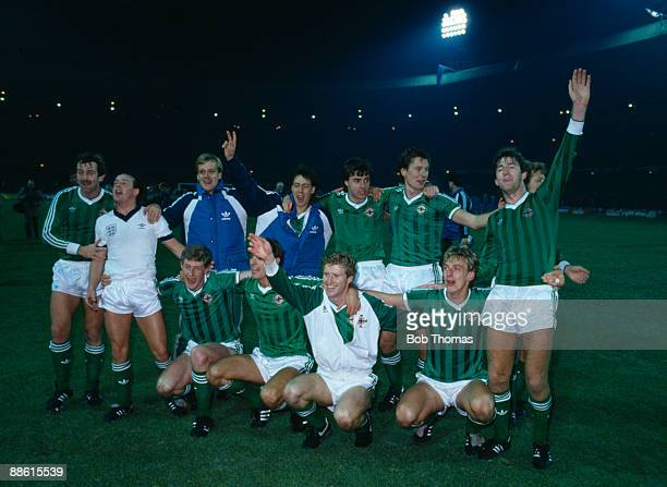 The Northern Ireland team celebrate after a 00 draw with England at Wembley Stadium had ensured their qualification for the 1986 World Cup Finals...
