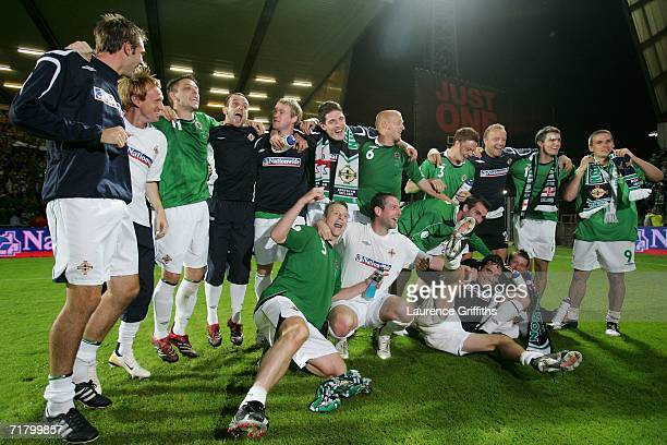 The Northern Ireland team celebrate victory during the Euro 2008 Qualifying Group F Match between Northern Ireland and Spain at Windsor Park on...