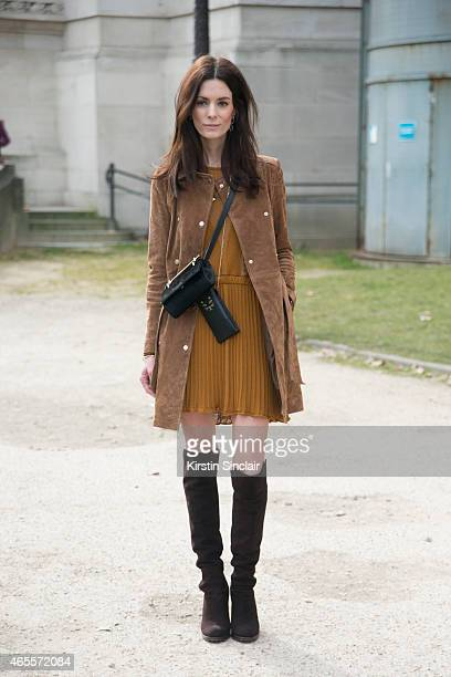 'The Northern Lightâ blogger Hedvig Opshaug wears Stuart Weitzman shoes Mango coat Dagmar dress Charlotte Olympia bag and M2 Mallitier bag on day 5...