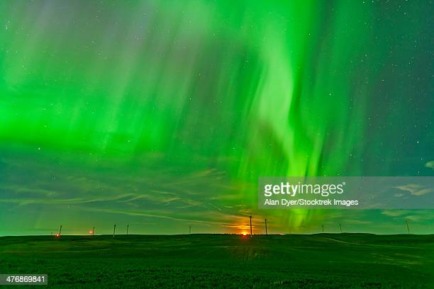 The northern lights as seen from the Wintering Hills Wind Farm, Alberta, Canada.