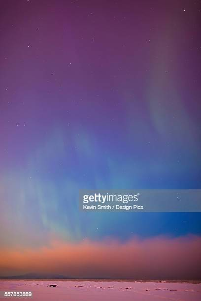 the northern lights dance in the sky above mount susitna viewed from the tony knowles coastal trail fog over knik arm in winter - mt. susitna stock pictures, royalty-free photos & images
