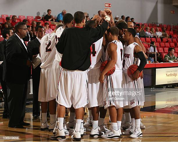 The Northridge Matadors and head coach Bobby Braswell left huddle before the exhibition game against the Redlands Bulldogs on November 5 2010 at the...