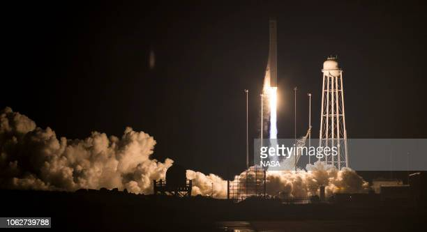 The Northrop Grumman Antares rocket with Cygnus resupply spacecraft onboard launches from Pad0A at NASA's Wallops Flight Facility on November 17 2018...