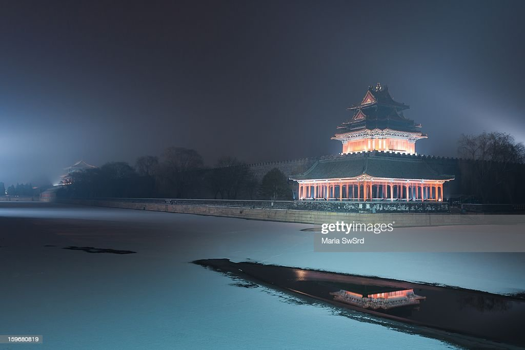 CONTENT] The northwest corner tower of the Forbidden city party reflected in the river. Lots of snow and ice.
