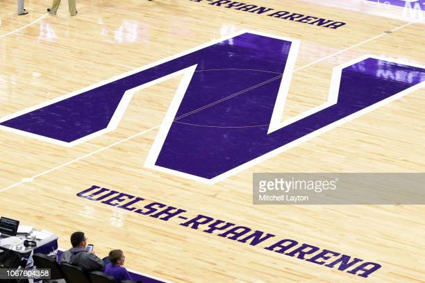 The Northwestern Wildcats logo on the floor during a college basketball game against the American University Eagles at the WelshRyan Arena on...