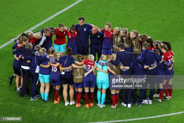 The Norway players and staff form a team huddle after the 2019 FIFA Women's World Cup France Quarter Final match between Norway and England at Stade...