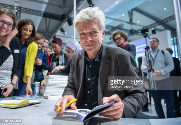 The Norwegian author Karl Ove Knausgard signs his books at the Frankfurt Book Fair on October 16 2019 in Frankfurt am Main Germany The 2019 fair...