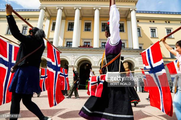 The Norwegian Crown Prince Haakon Prince Sverre Magnus Princess Ingrid Alexandra Crown Prince Mette Marit Queen Sonja and King Harald wave from the...
