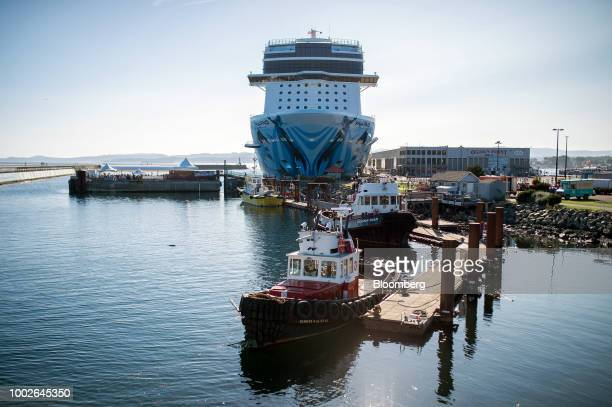 Water taxis pass in front of Fisherman's Wharf in downtown Victoria British Columbia Canada on Friday July 13 2018 Canadian tourism spending rose 02%...